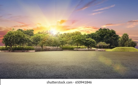Empty street at the nice and comfortable garden under the sunset with sun flare
