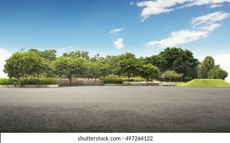 Empty street at the nice and comfortable great garden under lovely blue sky - Shutterstock ID 497264122