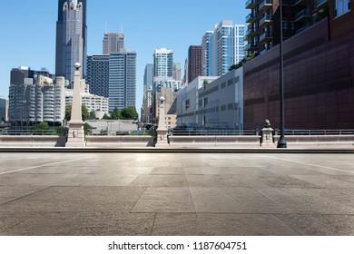 empty street through modern city in chicago