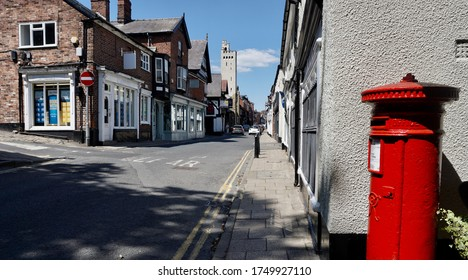 Empty street view in lockdown with shopfronts in Knutsford Cheshire England on a sunny day June 2020