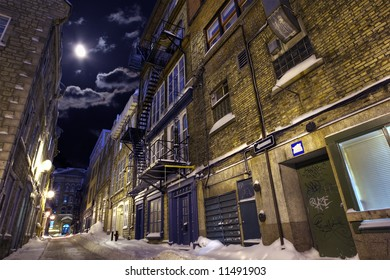 Empty street in a winter night highlighted by moon