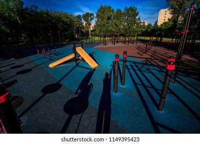 Empty street workout place in summer morning. City sport recreation with coating of rubber chips. Healthy lifestyle concept
