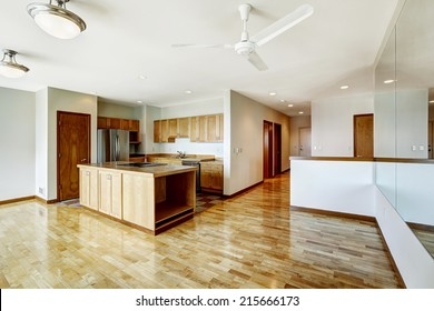 Empty studio. Living room with large mirior and kitchen area. Down town of Seattle