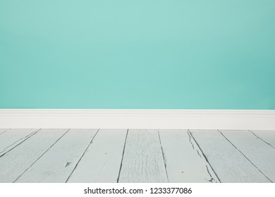 Empty studio living room with a wooden floor and blue wall paper background with copy space