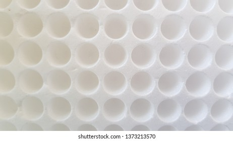 Empty styrofoam packing box with round holes for medical test tubes. Circle pattern abstract background. Geometric shaped white backdrop.