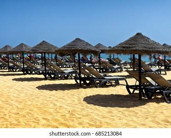 Empty sun beds on Albufeira Beach, Portugal