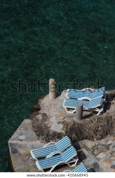 Empty sunbeds on a seaside.