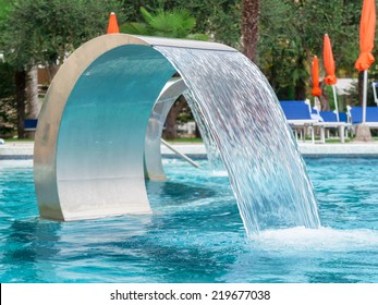 Empty Swimming pool in spa with waterfall jet