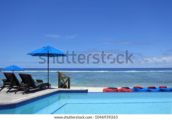 Empty swimming pool in tropical island resort in Rarotonga , Cook Islands.