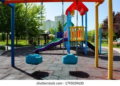 Empty swing set and colorful playground park no kids due to coronavirus, Covid-19. Cayyolu Ankara Turkey