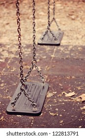 Empty swings on playground