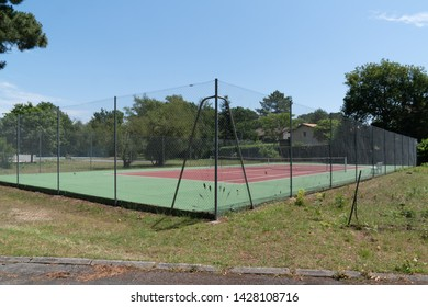 Empty synthetic outdoor green red tennis court
