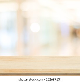 Empty table and blurred store with bokeh background, product display template.