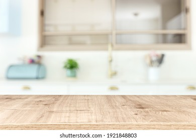 empty table board and defocused modern kitchen background. product display concept