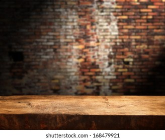 Empty table and brick wall in background. Great for product display.