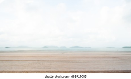 Empty table with bright sky and the beach background for montage product display
