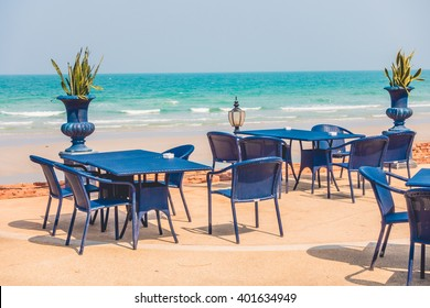 Empty table and chair around beach background - Vintage Filter