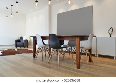 Empty table and chairs in luxury living room
