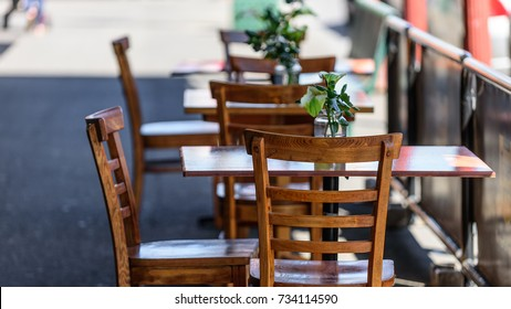 Empty table and chairs at a street cafe in Melbourne, Australia.