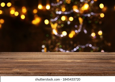 Empty table in front of christmas tree with decorations background. For product display montage