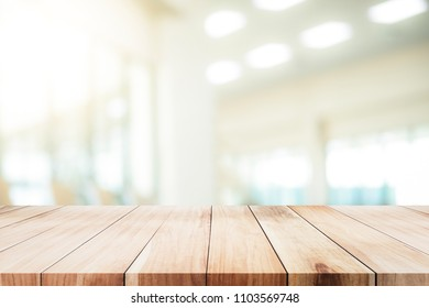 Empty table for present product with office background.