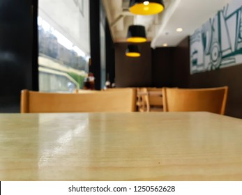 empty table in restaurant with art graphity wall