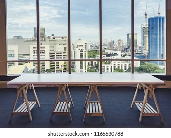 empty table in the room office and window city view background.For montage product display or design key visual layout.