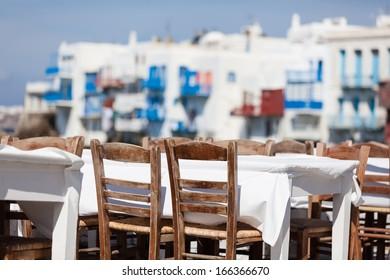 An empty table at seaside cafe,Mykonos
