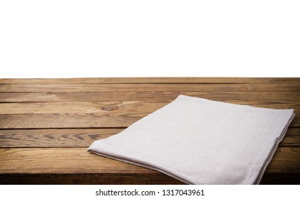 Empty tablecloth on wood table isolated on white background. Selective focus. Place for food. Top view. Mockup and template copy space.
