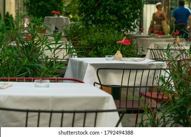 empty tables in a cafe on the street without people and customers