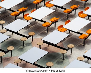 empty tables chairs set in rows of large university school canteen lunch room easy clean industrial style design white top plate wooden and plastic seats on fixed metal frame construction top view