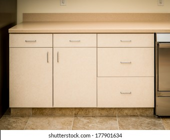 Empty tan kitchen counter and cabinet minimalist style
