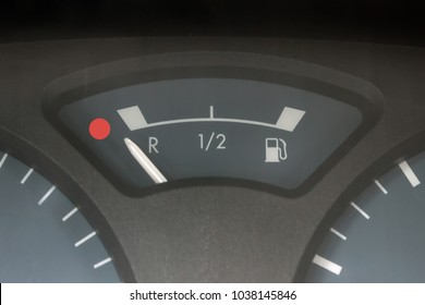 Empty tank indicator on car dashboard. Concept - economic crisis, deficit, lack of money, lack of strength and health, fatigue, fuel consumption.