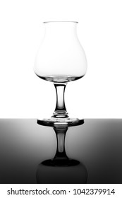Empty Tasting Beer Glass with Stem and Reflection Isolated on White Background