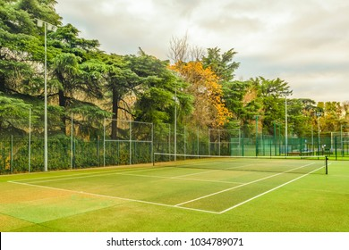 Empty tennis court at El Retiro historic gaden park, Madrid city, Spain