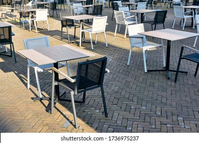 Empty terrace of a closed restaurant in The Netherlands with plenty of space between tables and chairs during coronavirus restrictions waiting to reopen. Social distancing concept.