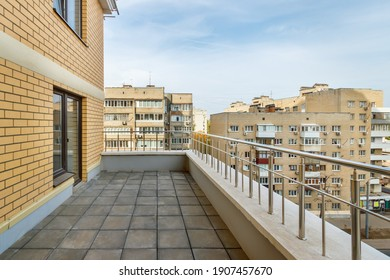 Empty terrace on modern new high-rise residential building in city.