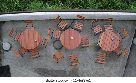 The empty terrace on the top with tables and chairs