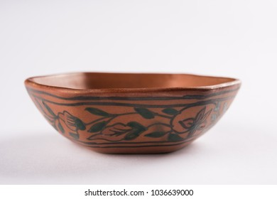 Empty terracotta bowl or brown clay serving bowl or soup bowl isolated over white background
