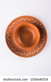 Empty terracotta soup bowl or brown clay serving bowl isolated on white