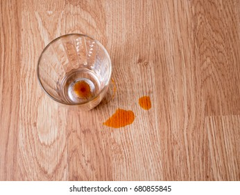 Empty Thai milk tea glass with stain on wooden background, waiting for cleaning concept