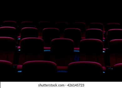 Empty theater auditorium or cinema with red seats