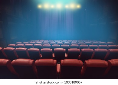 empty theater auditorium or movie cinema with red seats before show time