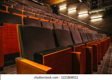 Empty theatre or cinema auditorium hall with rows of seats or chairs