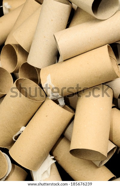Empty Toilet Rolls Stack Up On a Black Background