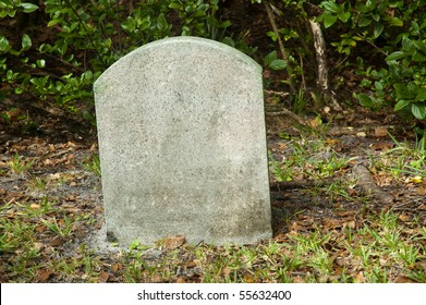 Empty tombstone on a graveyard
