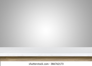 Empty top of granite stone table on grey wall background. For product display