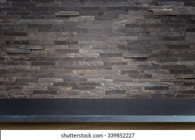 Empty top of natural stone table and stone wall background. For product display