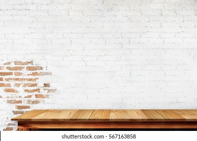 Empty top of natural wooden table and retro white brick wall background. For product display