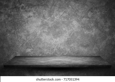Empty top stone shelves with grunge dark cement or concrete wall texture  background.Counter for display or montage of product.